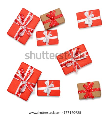 Set of wrapped gift boxes with ribbon bows, isolated on white - stock photo
