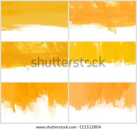 Set of 6 yellow hand-painted brush stroke daub backgrounds - stock photo