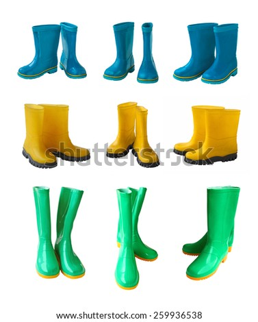 Set 9 pair of yellow , blue and green gumboots isolated on white background - stock photo