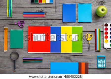 Set school supplies on a wooden table, top view. Back to school - stock photo