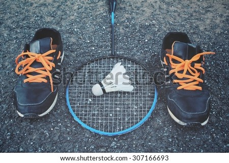 Set sports of sport shoes and shuttlecocks with badminton racket.
