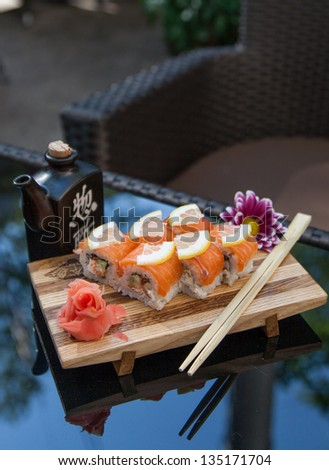 "Set sushi ""Geisha"" on wooden plate served on a table"