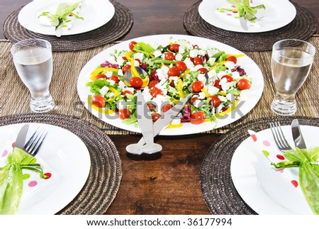 Set table with lovely vegetable salad - focus on the salad