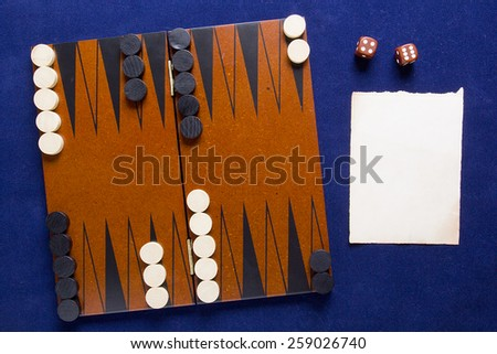 Set to play backgammon, and a piece of paper. - stock photo