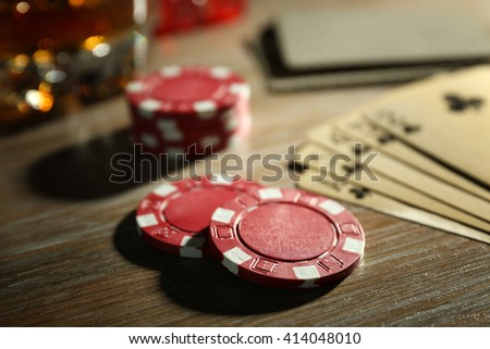 Set to playing poker with cards and chips on wooden table closeup - stock photo