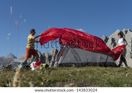 Set up a camp site - Overnight in the mountains - stock photo