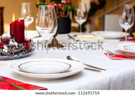 Set up christmas table inside a house - stock photo