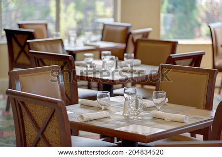 Set up table in a restaurant - stock photo