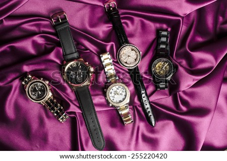 set watches on silk - stock photo