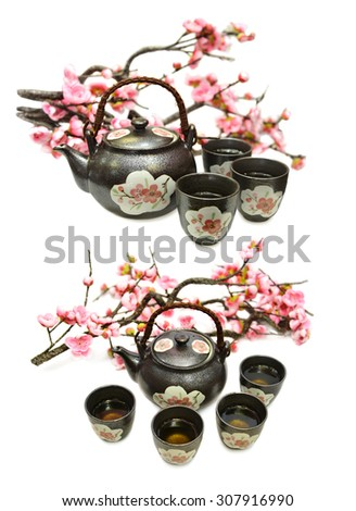 Set with black ceramic tea pot, cups and sakura branch, isolated objects, japanese tea ceremony - stock photo