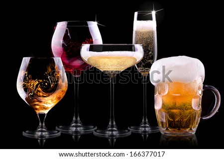 set with different drinks on black background - champagne, beer, cocktail, wine, brandy, whiskey, scotch, vodka, cognac