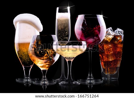 set with different drinks on black background - champagne,cola,cocktail,wine,brandy,whiskey,scotch,vodka,cognac - stock photo