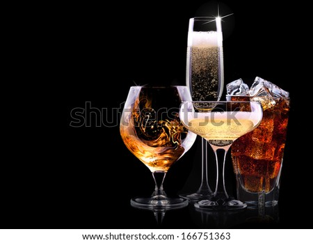 set with different drinks on black background - champagne,cola,cocktail,wine,brandy,whiskey,scotch,vodka,cognac