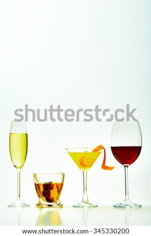 set with different drinks on white background - champagne, whiskey, cocktail, wine