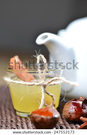 Set with honey, teapot and cinnamon sticks close up