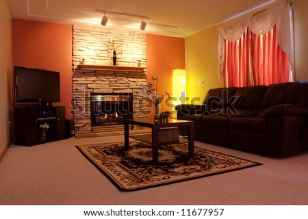 Set with nice ambient lighting this family room offers comfortable place for the family - stock photo