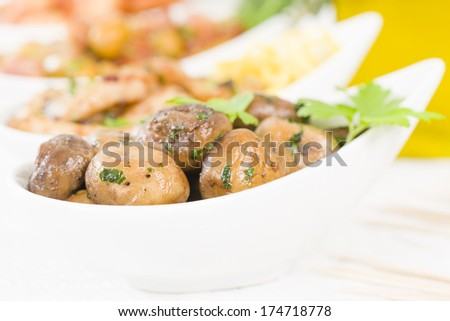 Setas al Ajillo - Sauteed mushrooms with garlic, lime and parsley. Traditional Spanish tapas dish.  - stock photo
