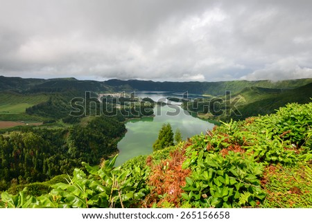 Sete Cidades Lagoon has Amazing natural landscape and is located in a volcanic crater on the island of Sao Miguel, Azores. Considered one of the wonders of Portugal, for its stunning scenery. - stock photo