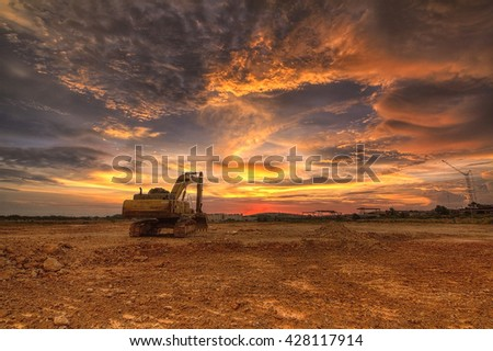 Setia Alam, Malaysia 29 May 2016, Yellow excavator on a construction site against sunset. - stock photo