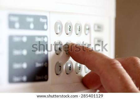 stock-photo-setting-security-alarm-28540