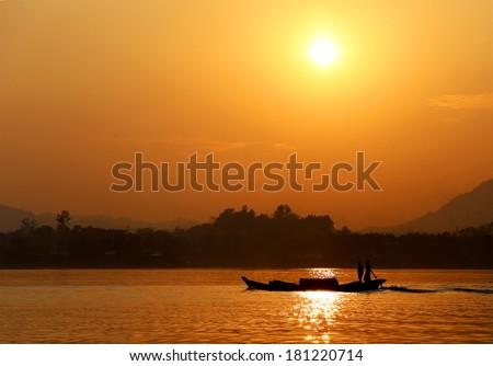 Setting sun at Kaptai lake of Bangladesh - stock photo