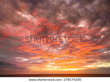 Setting Sun Burning Skies  - stock photo