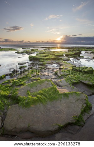 Setting sun on the coast at Maryport, a town within Allerdale borough of Cumbria, England. - stock photo