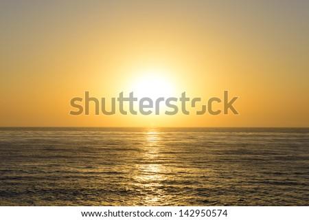 Setting sun on the pacific ocean. - stock photo