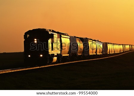 Setting sun reflecting off train and track