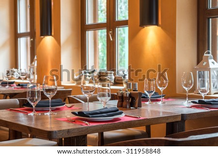 Setting table in the restaurant - stock photo