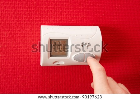 Setting the temperature - stock photo