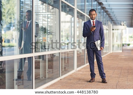 Setting up appointments for his business day - stock photo