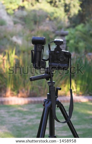Setting up the camera on a tripod - stock photo