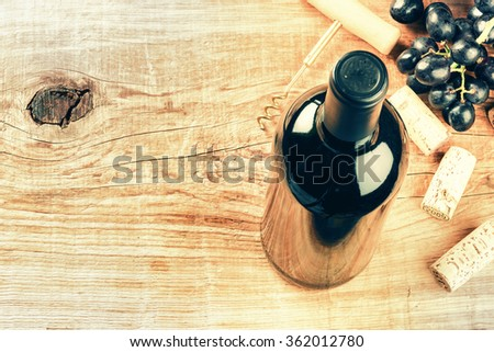 Setting with bottle of red wine, grape and corks. Wine list concept with copy space  - stock photo