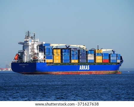 Setubal, Portugal, 16th April 2013, Container ship during maneuvers in port. - stock photo
