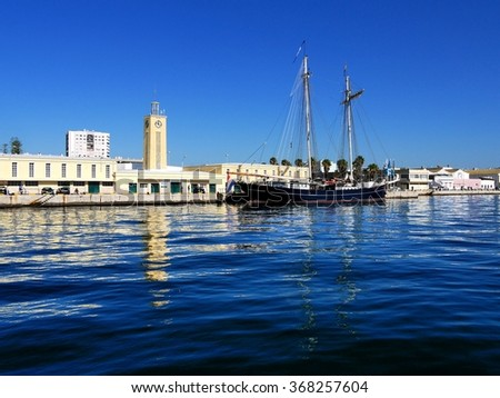 "Setubal, Portugal, 8th of November 2015, Tranquil Scene of worlds largest Topsail Schooner ""Wylde Swan"" in harbor at Setubal, Portugal during a youth sail training voyage. - stock photo"