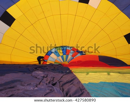setup inside of colorful hot air balloon - stock photo