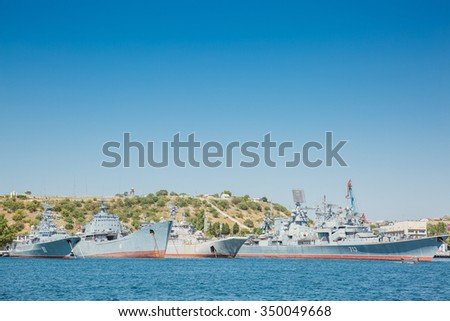 Sevastopol, Crimea - August 9, 2015: Black Sea Fleet warships are on the quay of the Sevastopol Bay. The view from the excursion boat.