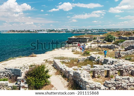 Sevastopol,Crimea - June 16, 2014:tourists stroll through the ruins of the ancient city of Chersonesos.Chersonesos based on the ancient Greeks Heracleian peninsula on the southwest coast of the Crimea