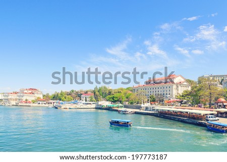 SEVASTOPOL, CRIMEA - MAY 7, 2014: Artillery Bay with touristic boat in the front