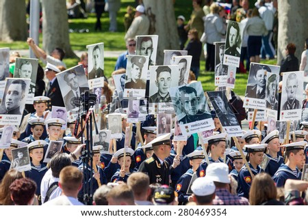 SEVASTOPOL, CRIMEA - MAY 9, 2015: The Immortal regiment marches. The parade in honor of 70th anniversary of Victory Day MAY 9, 2015, Sevastopol - stock photo