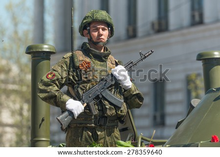 SEVASTOPOL, CRIMEA - MAY 9: The Victory Day parade of veterans and Russian military in honor of 70th anniversary on May 9, 2015 in downtown Sevastopol, Crimea. Crew of BTR-80 is greeted by the crowd. - stock photo