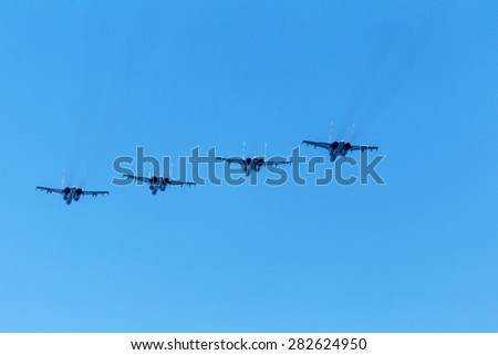 Sevastopol, Crimea, RUSSIA - May 9, 2015: Naval Aviation Russian Black Sea Fleet in the air. Military fighter. Military helicopters. Amphibious aircraft. Taken from below against the blue sky