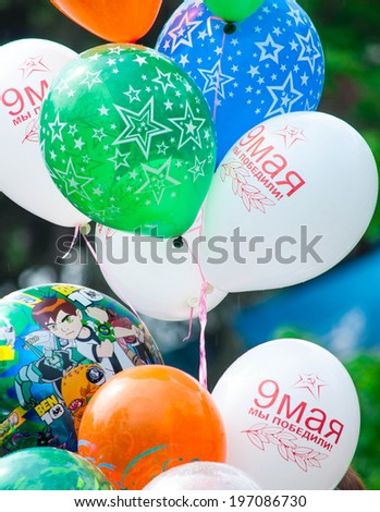 "SEVASTOPOL, RUSSIA - MAY 09: Celebrating the 69th anniversary of the Victory Day and 70th anniversary of Sevastopol liberation from fascists. Sevastopol 2014. Parade, balloons ""9 of May. We won!""  - stock photo"