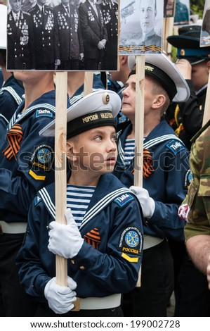 SEVASTOPOL, RUSSIA - MAY 09: Celebrating the 69th anniversary of the Victory Day and 70th anniversary of Sevastopol liberation from fascists. Sevastopol 2014. Parade, people with veteran photos.  - stock photo