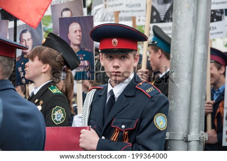 SEVASTOPOL, RUSSIA - MAY 09: Celebrating the 69th anniversary of the Victory Day and 70th anniversary of Sevastopol liberation from fascists. Sevastopol 2014. Parade, people with veteran photos.