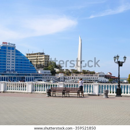 Sevastopol, Russia  - September 18, 2014: Primorsky boulevard, views of Hero-City obelisk and skyscrapers on cape Crystal