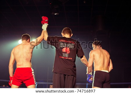SEVASTOPOL, UKRAINE - 03 APRIL: Winner Maslennikov at Ukrainian championship MIX FIGHT, April 03, 2011 in Sevastopol, Ukraine. - stock photo