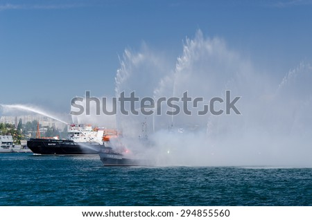 Sevastopol, Ukraine - July 26, 2013: Rehearsal, fireboat, writing on the board - Miner