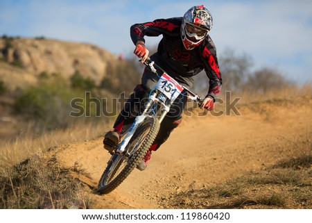 "SEVASTOPOL, UKRAINE - NOVEMBER 25: Unknown racer on the competition of the mountain bike ""Listopad Bike Session 2012"" on November 25, 2012 in Sevastopol, Ukraine - stock photo"